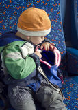 Child with backpack on train. Royalty Free Stock Image