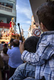 Child of backs with ramrod of drum in his hand with his father. During Holy week procession, Spain stock images
