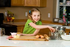 Child baker. A young girl making chocolate chip cookies in a home kitchen Stock Images