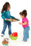 Child Baking. Adorable 3 year old Hispanic-African American girl, baking cookies over white background.  Giving cookies to little sister Stock Image