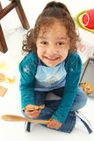 Child Baking. Adorable 3 year old Hispanic-African American girl, baking cookies over white background Stock Photo