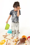 Child Baking. Adorable 7 year old french american boy making mess baking cookies Stock Photos