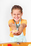 Child baking cookies Stock Images