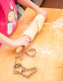 Child baking cookies in christmas time Royalty Free Stock Photo