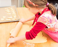 Child baking cookies in christmas time Royalty Free Stock Images