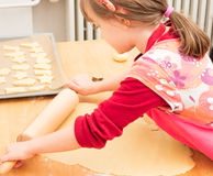 Child baking cookies in christmas time Royalty Free Stock Image