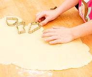 Child baking cookies in christmas time Stock Photo