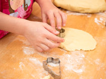 Child baking cookies in christmas time Stock Image