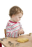 Child baking cookies isolated on white background Royalty Free Stock Photography