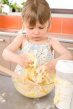 Child baking - little girl kneading dough Royalty Free Stock Photos