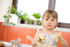 Child baking - little girl kneading dough Stock Image