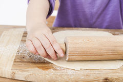 Child baking pie Royalty Free Stock Photo