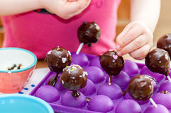 Child baking. Young child baking chocolate cake Royalty Free Stock Photography