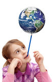 Child balance the earth. On pencil Stock Image
