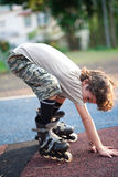 Child balancing himself while learning to rollerbl Royalty Free Stock Photos