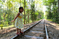 Child balancing. Little girl trying Child balancing on train line track Royalty Free Stock Photos