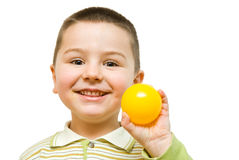 Child with ball. Child playing with yellow ball Royalty Free Stock Photography