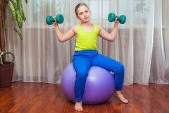 Child  with  on the ball for fittnesa at home Stock Photos