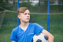 Child with ball playing football Royalty Free Stock Photography
