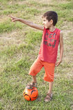 Child ball pointing Royalty Free Stock Image