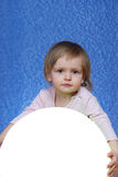Child with ball, portrait on a blue background Royalty Free Stock Photography
