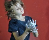 Child with a ball of powder magnesia chalk Royalty Free Stock Photo