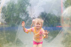 Child in the ball in water Stock Photography