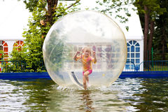 Child in the ball in water Royalty Free Stock Images