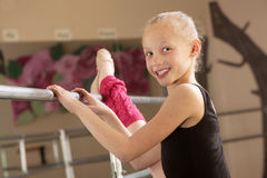 Child Ballerina Stretching Her Leg Stock Image