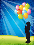 Child with ballons Stock Images