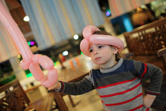 Child with balloon sword Royalty Free Stock Photo