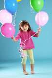 Child with balloons Stock Photo