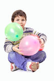 Child and balloons. Little boys with balloons of different colors on white background Stock Image