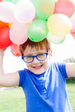 Child  with balloons . Royalty Free Stock Photos