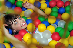 Child with balls Royalty Free Stock Images