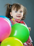 Child with baloons Royalty Free Stock Images