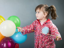 Child with baloons Stock Photo