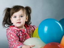 Child with baloons Stock Photography