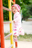 Child on bars. Child climbing on bars at schoolyard royalty free stock photos