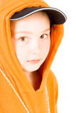 A child in a baseball cap. Close up of a child in a baseball cap and tracksuit Royalty Free Stock Photo