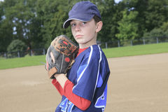 Child baseball pitchen on the field Stock Photography