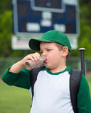 Child baseball player drinking chocolate milk. After game Royalty Free Stock Images
