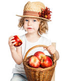 Child with basket of apples Royalty Free Stock Images