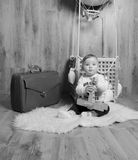 He child in the basket of the balloon plays, black and white Stock Image