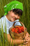 Child with basket of the berries Royalty Free Stock Photos