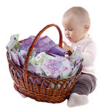Child with a basket of euro Royalty Free Stock Image
