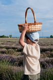 Child with a basket in the field. Child carrying a basket on the air Stock Photography