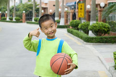 A child with a basketball Stock Image