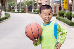 A child with a basketball Stock Photos