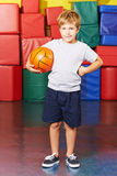 Child with basketball in gym Stock Photography